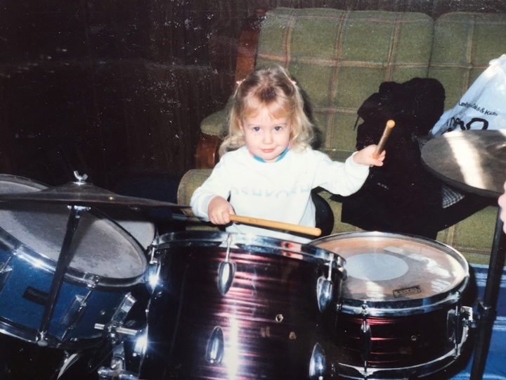 Little Margo playing drums